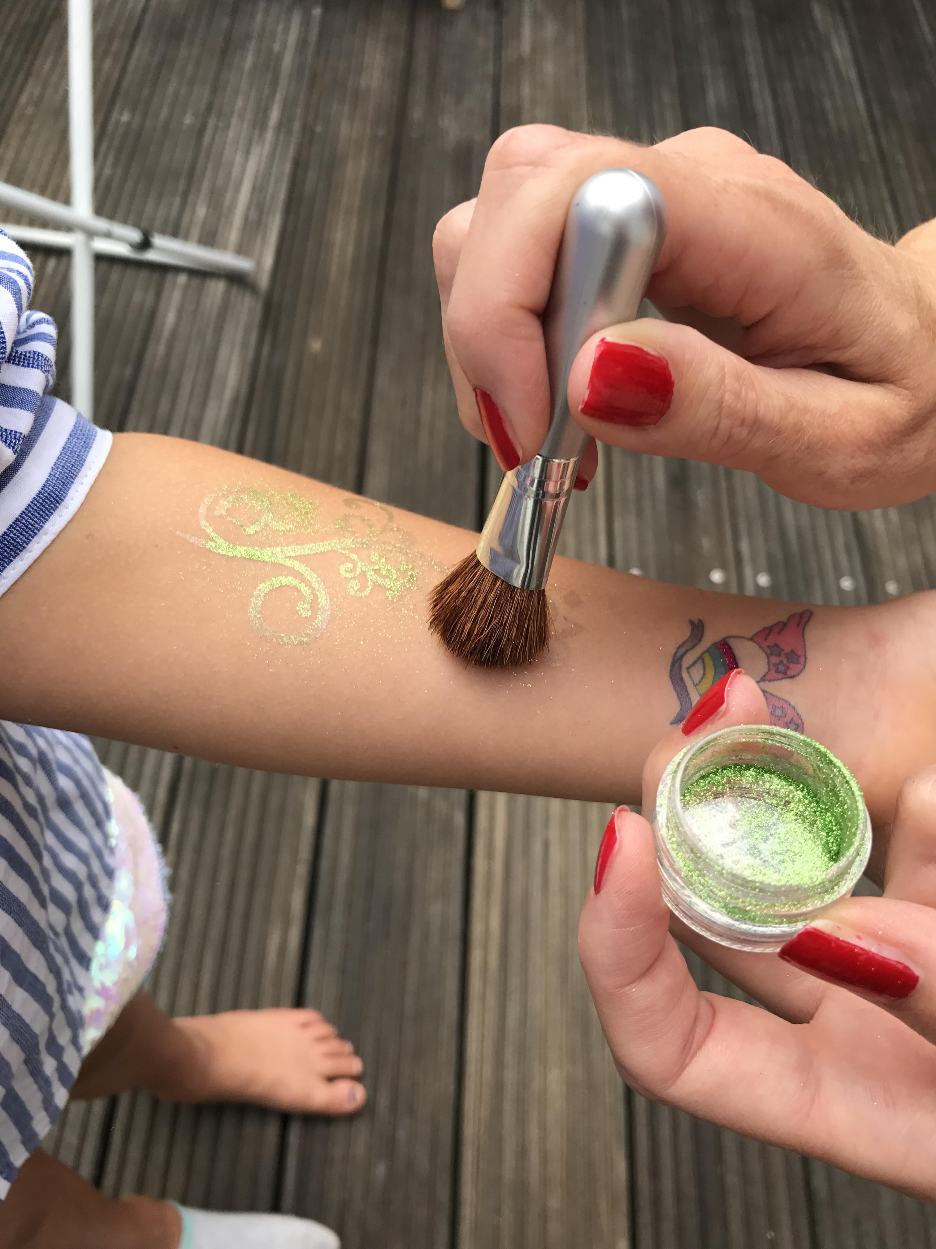 Glitter tattoos for children self-made