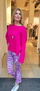 Pink sweater with colorful leggings