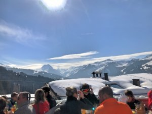 Skiing and pausing under the sun
